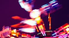 Amusement park carnival ride at night Stock Footage