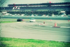 Racecars Racing At Racetrack Stock Footage