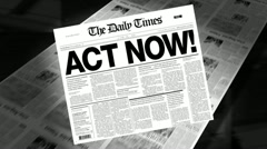 act now! - newspaper headline - stock footage
