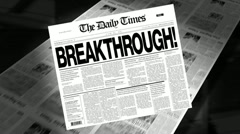 Stock Video Footage of breakthrough! - newspaper headline
