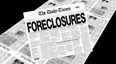 Stock Video Footage of foreclosures - newspaper headline