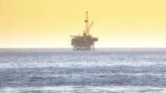 offshore oil rig drilling platform - pacific coast - stock footage
