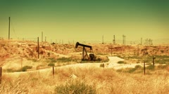 Oil pump in the desert Stock Footage