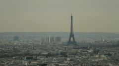 The stunning Eiffel Tower rising above the city of Paris Stock Footage