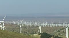 Stock Video Footage of Wind Power Turbines (Green Hills & Blue Sky)