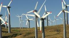 Stock Video Footage of Wind Power Turbines (Hills & Blue Sky)