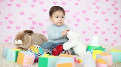 Happy kid with a teddy bear and gifts Stock Footage