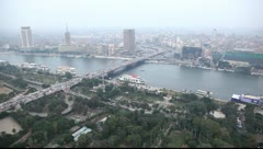 Aerial view on the Cairo city roads and Nile river in dusk Stock Footage