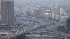 Hard traffic road at evening. Aerial Cairo view, crowded viaduct at junction - stock footage