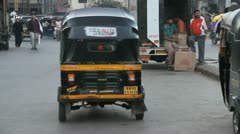 Rickshaws driving away from a station in Mumbai Stock Footage