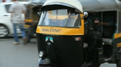 A rickshaw carrying passengers in Mumbai, India Stock Footage