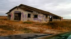 Car Infront Of Old Building With Graffiti - stock footage