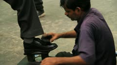 Shoe shining in a train station in Mumbai, India Stock Footage