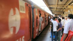 A train pulls into a station in Mumbai, India Stock Footage
