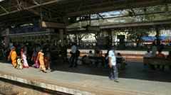 View from a train as it pulls into a station in Mumbai, India Stock Footage
