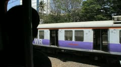 Shot from a train carriage, with another train passing in Mumbai, India Stock Footage