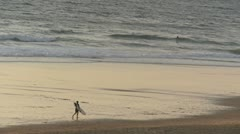 Surfer walking on Lacanau beach 02 Stock Footage