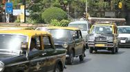 Busy traffic and taxis speeding by in Mumbai, India Stock Footage