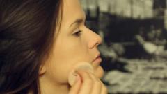 Beautiful model put make up- close up Stock Footage