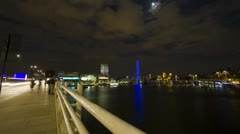 Time Lapse of Waterloo Bridge and the river Thames and London Eye at night Stock Footage