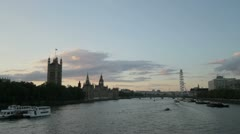 The River Thames at dusk with the Houses of Parliament and the London Eye Stock Footage