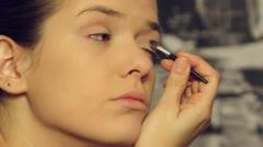 Beautiful model put make up- close up-Eyelids. Stock Footage