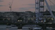 The London Eye and bridges over the River Thames at dusk Stock Footage