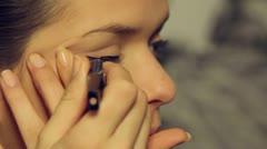 Beautiful model put make up- close up-eye liner. Stock Footage
