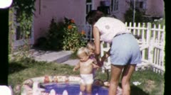Young Mother and Dirty Babies in Kiddie Pool 1950s Vintage Film Home Movie 1593 Stock Footage