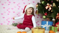 Baby girl doll in santa hat Stock Footage