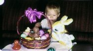Stock Video Footage of Baby Girl and Easter Bunny Basket (Vintage Film Home Movie) 1954