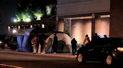 Black Friday bargain hunters camped outside store Stock Footage