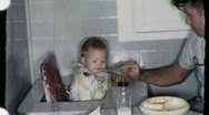 Stock Video Footage of Father Feeds Fussy Baby Circa 1955 (Vintage Film Home Movie Footage) 1597