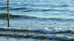 Fishing nets in the sea shallows Stock Footage