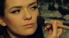 Beautiful model put make up-close up. Stock Footage