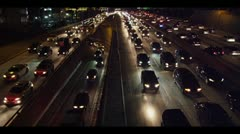 LA night 01 -110 Fway Traffic Jam wMarriot Hotel Searchlights by lightchaser Stock Footage