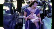 Stock Video Footage of MOTHER Getting Baby Out of Car 1960s 50s (Vintage Retro Film Home Movie) 1598