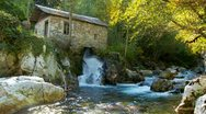 Water comes out from old stone mill on the river Stock Footage