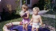 Stock Video Footage of Baby Boys Play in Backyard Kiddie Pool 1950s Vintage Film Home Movie Retro 1603