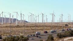 Renewable Energy - Wind Turbines and Traffic - stock footage