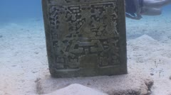 Female diver with Mayan sculpture Stock Footage