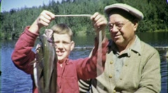 PROUD GRANDSON GRANDFATHER Fishing Big Trout 1950s Vintage Film Home Movie 1615 Stock Footage