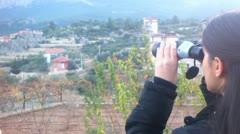 Woman watching nature by binoculars - stock footage