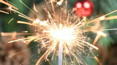 Christmas tree, mirror ball and lit sparkler. Stock Footage