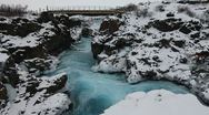 Stock Video Footage of bridge over glacial river, Barnafoss, Iceland