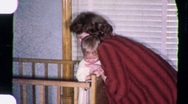 Stock Video Footage of MOTHER Putting Crying Fussy Baby to Bed CRY 1950s Vintage Film Home Movie 1601