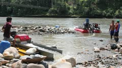 Suction dredge mining placer gold deposits Stock Footage