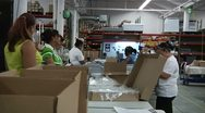 Stock Video Footage of Women packaging in factory