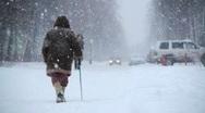 Elderly man walks at winter street Stock Footage