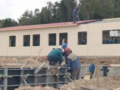 Workers concrete foundations and roof house. Stock Footage
